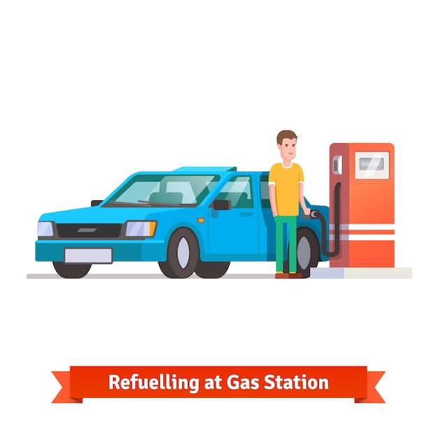 Hombre reabastecimiento de combustible de su coche en la gasolinera Vector Gratis