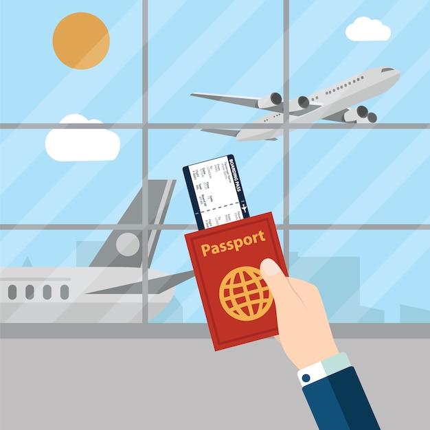 Hombre sujetando pasaporte en aeropuerto vector gratuito