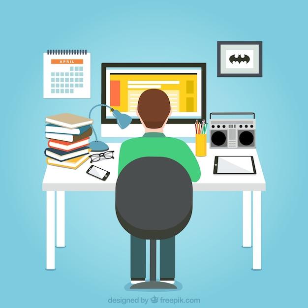 Hombre trabajando en su ordenador | Descargar Vectores Premium