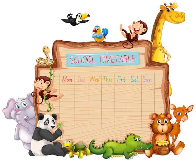 Horario escolar de animales en blanco vector gratuito