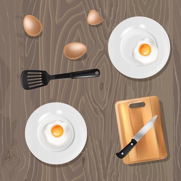 Huevos fritos cocidos desayuno comida en platos en la mesa Vector Premium