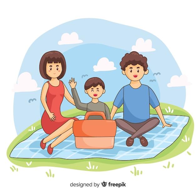 Ilustración dibujada a mano familia haciendo un picnic vector gratuito