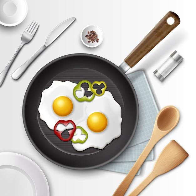 Ilustración de huevos fritos en una sartén con pimiento para el desayuno y otros utensilios Vector Premium