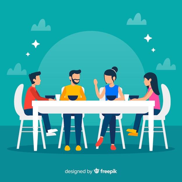 Ilustración plana familia sentada alrededor de la mesa vector gratuito