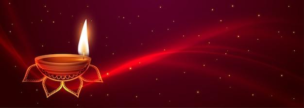 Impresionante pancarta feliz festival de diwali con efecto de luz brillante vector gratuito