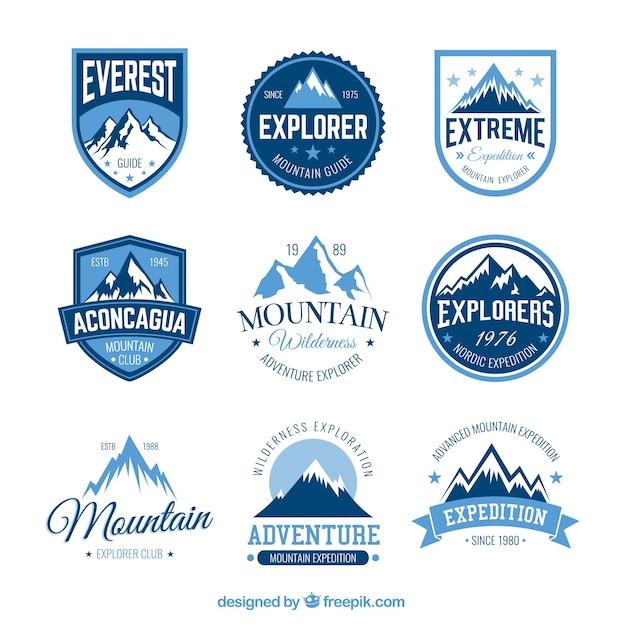 Insignias aventura en la montaña vector gratuito