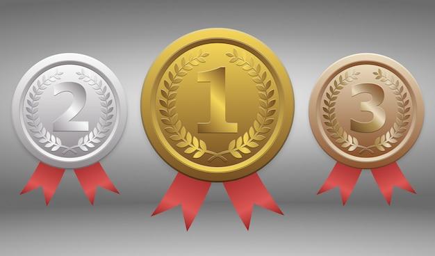 Insignias de oro, plata y bronce Vector Premium