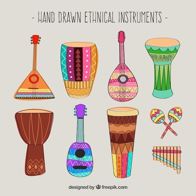 Instrumentos dibujados a mano étnicos vector gratuito