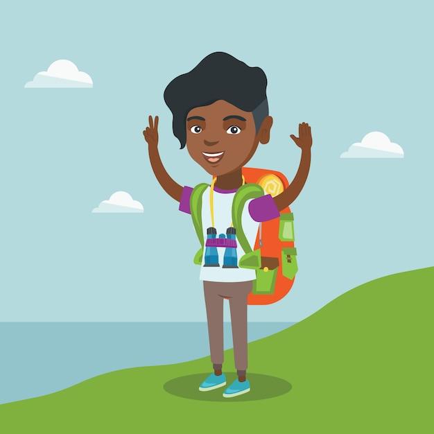 Joven turista disfrutando del paisaje con las manos arriba. Vector Premium