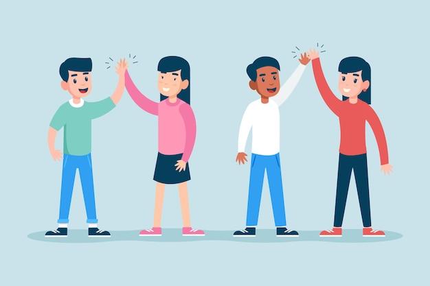 Jóvenes amigos dando cinco vector gratuito