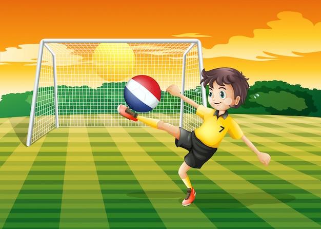 Una jugadora de fútbol usando la pelota de holanda vector gratuito