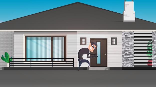 El ladrón está tratando de romper la puerta. Vector Premium