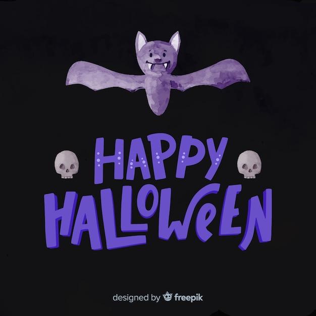 Letras de feliz halloween con murciélago morado vector gratuito