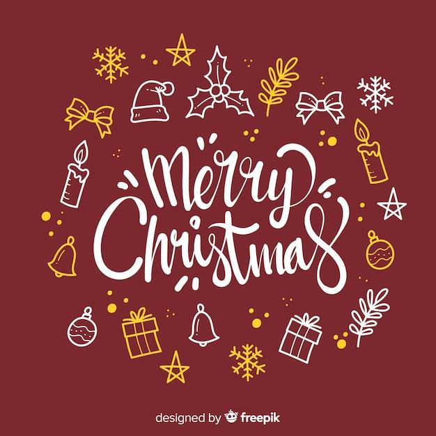 Letras de feliz navidad con elementos de decoración vector gratuito