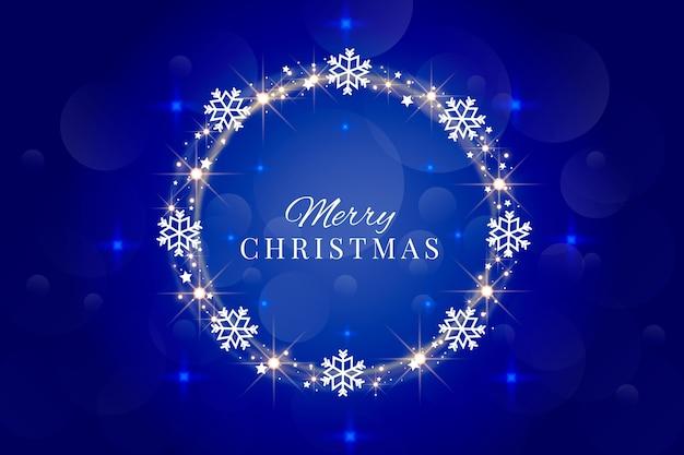 Letras de feliz navidad con marco de copos de nieve vector gratuito