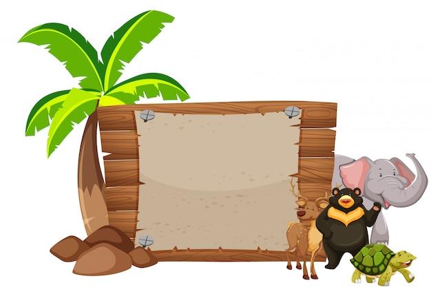 Letrero de madera y animales salvajes vector gratuito