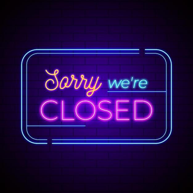 Letrero de neón 'lo siento, estamos cerrados' en la pared de ladrillo vector gratuito