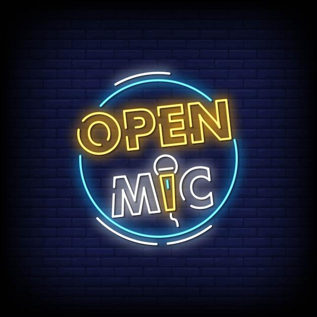 Letrero de neón de micrófono abierto en pared de ladrillo Vector Premium