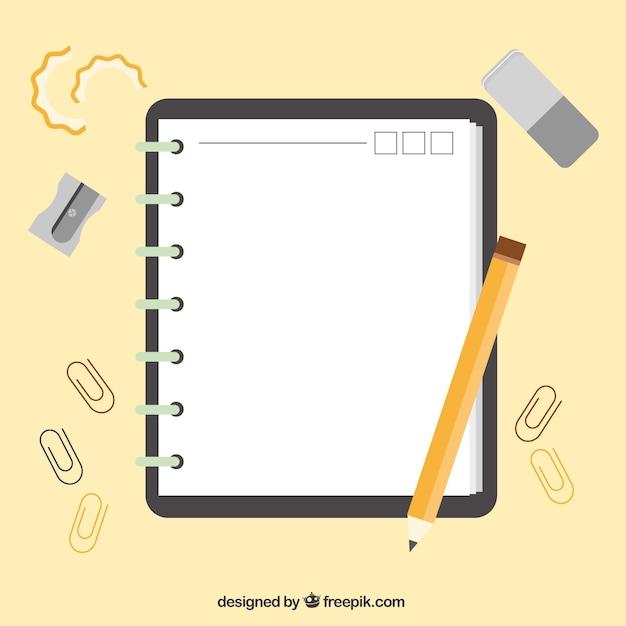 Libreta con accesorios en diseño plano  Vector Gratis