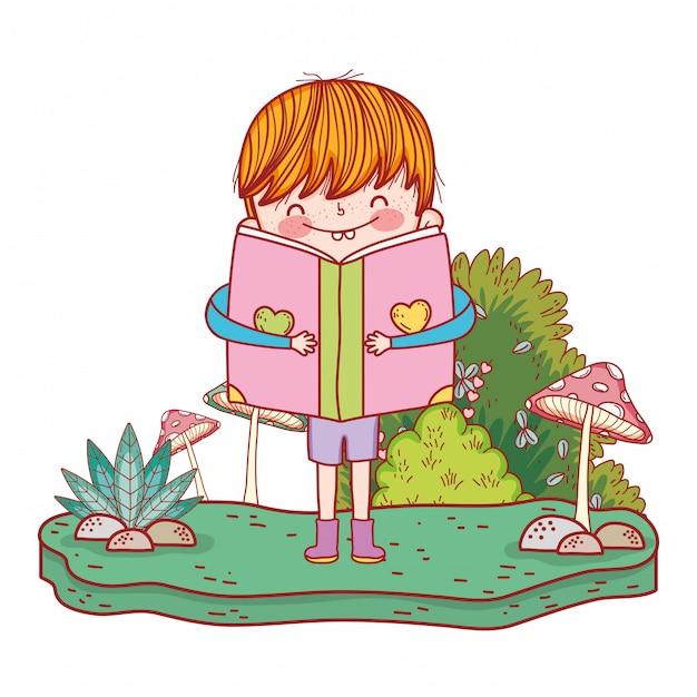 Libro de lectura feliz del niño pequeño en el paisaje Vector Premium