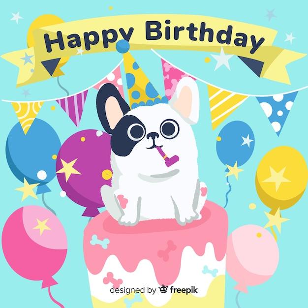 Linda tarjeta de cumpleaños con perro en un pastel vector gratuito