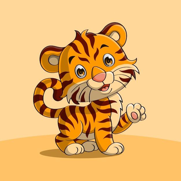 Lindo bebé tigre agitando una mano Vector Premium