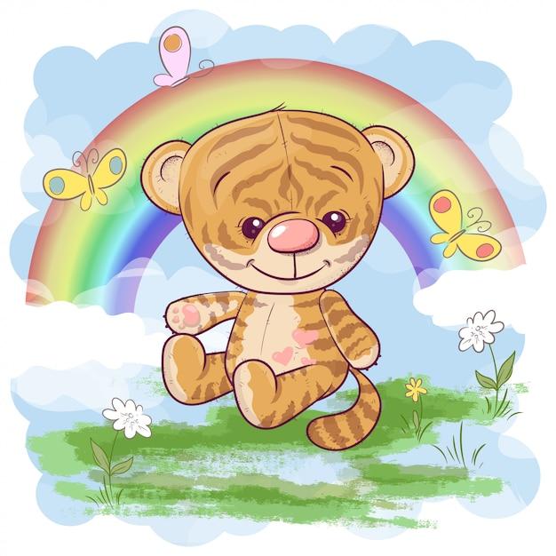 Lindo cachorro de tigre con el arco iris. estilo de dibujos animados Vector Premium