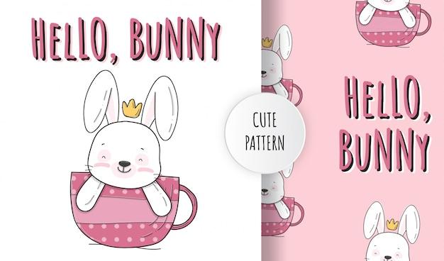 Lindo conejito plano en la ilustración de patrón animal de taza Vector Premium