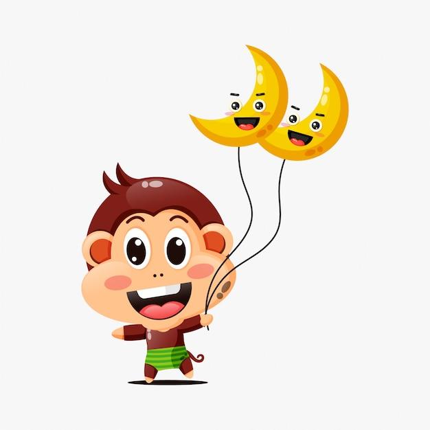 Lindo mono sosteniendo un globo lunar Vector Premium