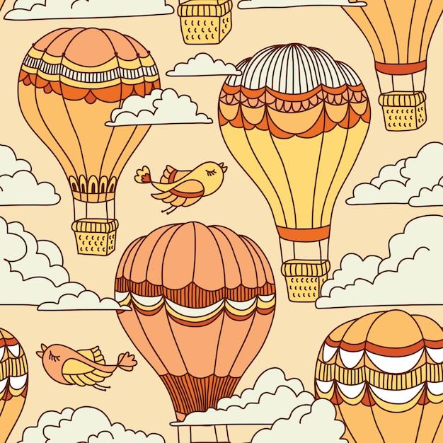 Lindo patrón sin fisuras con globos de aire caliente, pájaros y nubes Vector Premium