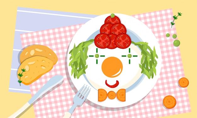 Lindo payaso comestible en un plato, hecho de tomates, huevos fritos, guisantes, ensalada y zanahoria por padres amorosos y creativos para sus hijos. problema de comer exigente. retos parentales. salud y bienestar. Vector Premium