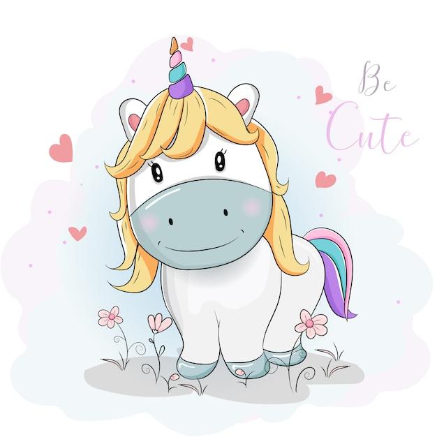 Lindos dibujos animados de unicornios en los campos de flores Vector Premium