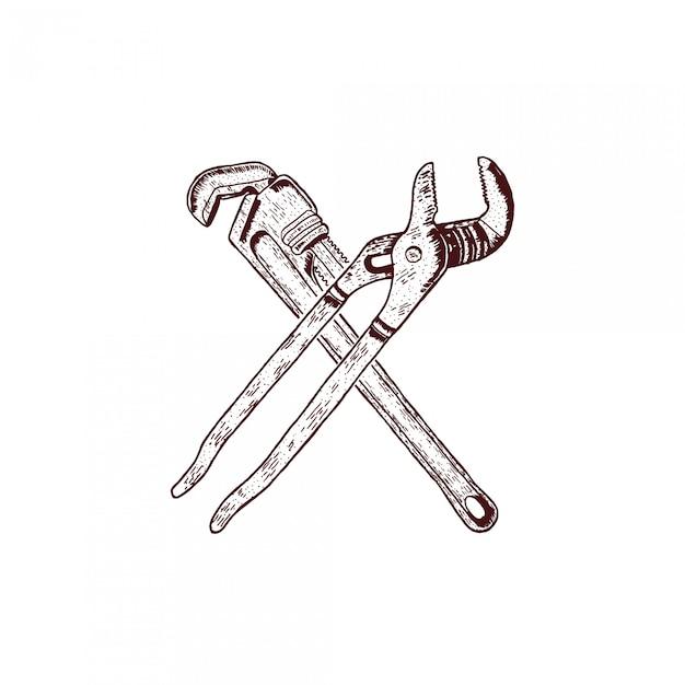 Llave cruzada dibujo a mano grabado Vector Premium