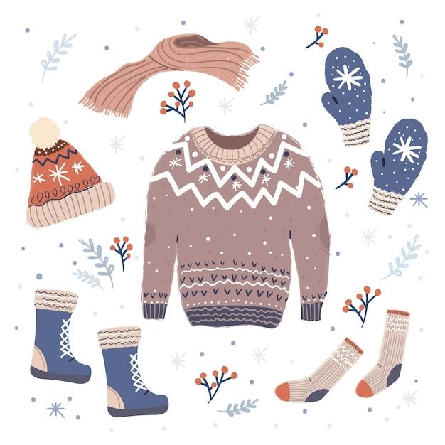 Lo esencial y ropa de invierno dibujada a mano. vector gratuito