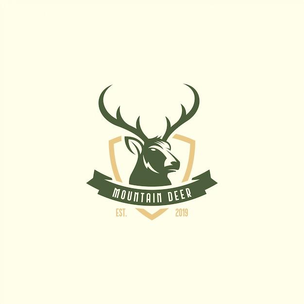 Logo de ciervos vintage Vector Premium