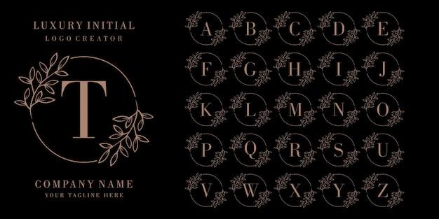Logotipo de insignia inicial de lujo Vector Premium