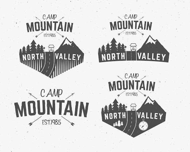 Logotipos de camping de montaña Vector Premium