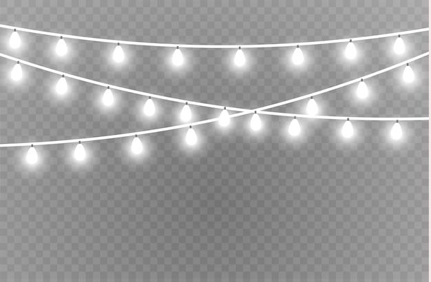 Luces de navidad elementos realistas. luces brillantes para tarjetas de navidad, pancartas, carteles, diseño web. decoraciones de guirnaldas. lámpara led de neón Vector Premium