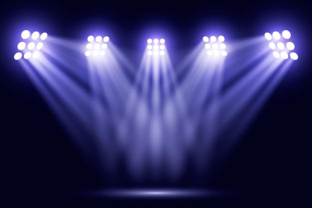 Luces reflectoras brillantes azules en estadio vector gratuito