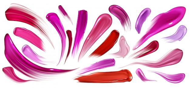 Manchas de lápiz labial, esmalte de uñas o pintura, pinceladas fijadas aisladas en blanco. vector gratuito