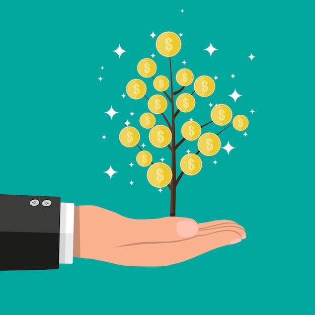 Mano de hombre de negocios con árbol de monedas. Vector Premium