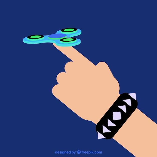 Mano jugando con un spinner azul vector gratuito