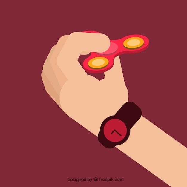 Mano jugando con un spinner rojo vector gratuito
