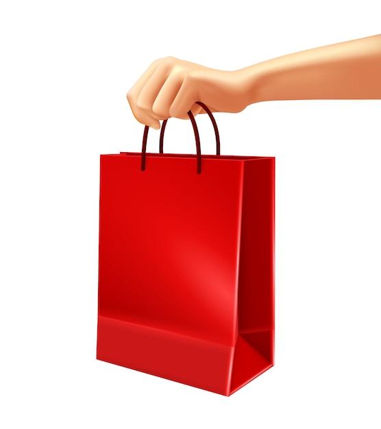 Mano que sostiene el ejemplo rojo del bolso de compras vector gratuito