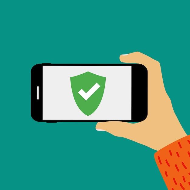 Mano que sostiene el teléfono móvil con plantilla de pantalla de escudo de seguridad. Vector Premium