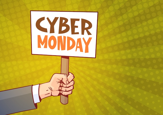 Mano sosteniendo carteles con texto cyber monday sobre sunburst Vector Premium