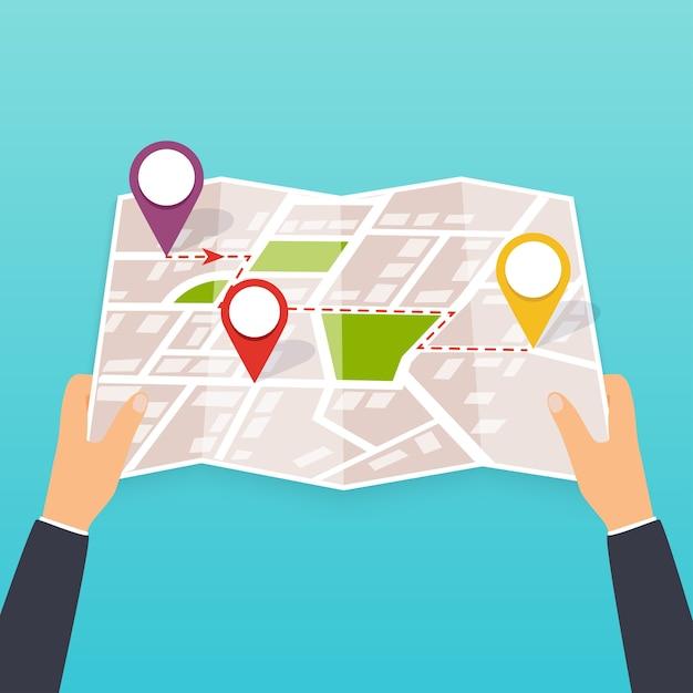 Mano sosteniendo un mapa de papel con puntos. turista mira el mapa de la ciudad. ilustración en formato. concepto de viaje. Vector Premium