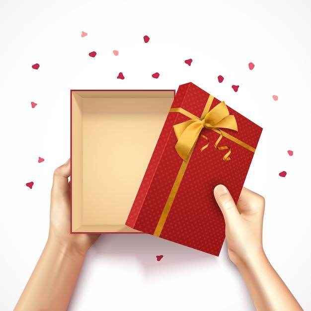 Las manos que sostienen el fondo realista 3d de la vista superior de la caja de regalo con el arco y el confeti de oro de la caja rectangular roja vector el ejemplo vector gratuito