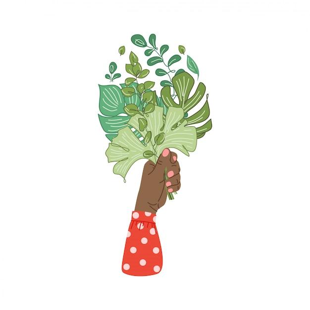 Manos sosteniendo la composición de ramo de ramas de plantas tropicales, hojas. mano femenina sosteniendo flores. elemento de diseño decorativo floral aislado en blanco Vector Premium