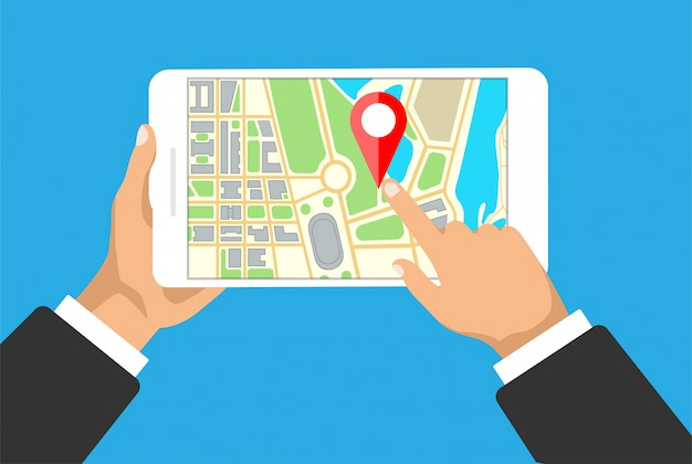Manos tiene tableta con navegación de mapa en una pantalla. navegador gps con punta roja. mapa de la ciudad con marcadores de puntos. Vector Premium